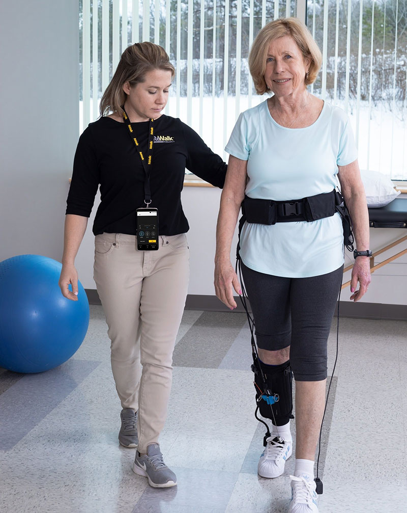 Woman walking with an exosuit