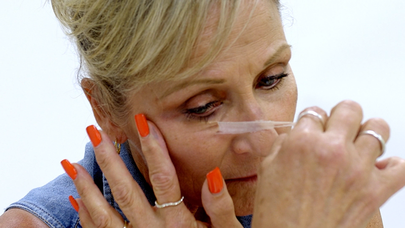Lady removing second skin from her face