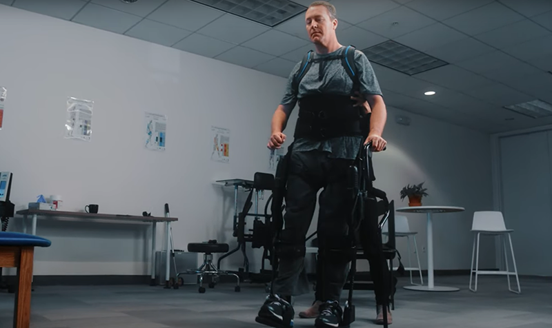 Man walking with the help of an exosuit