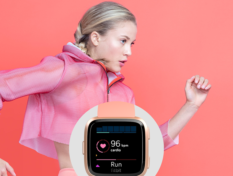 A woman runner and a smartwatch