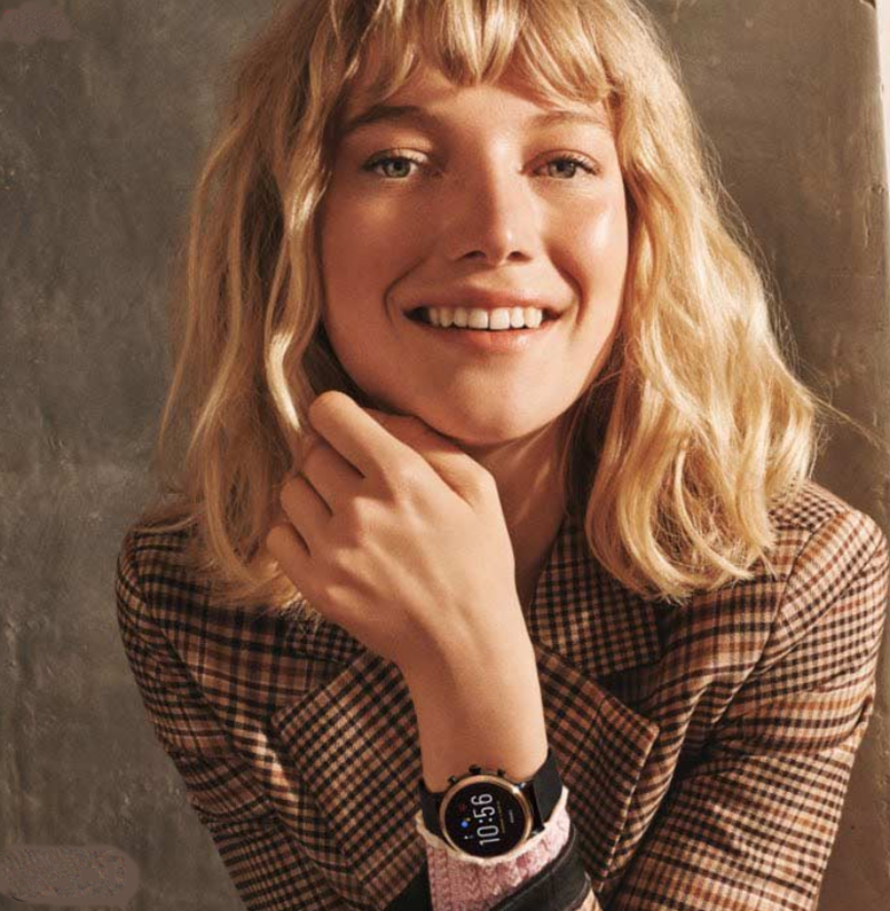 A woman wearing a smartwatch