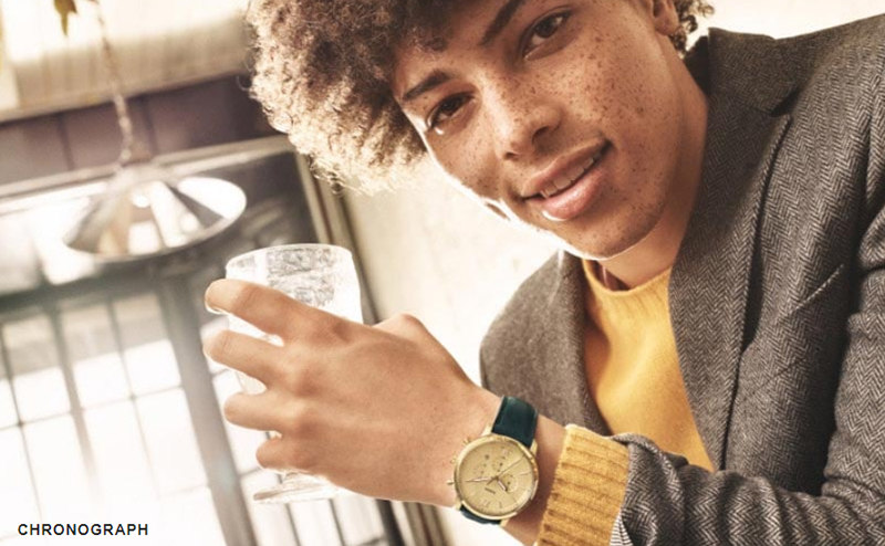 A man wearing a Fossil smartwatch