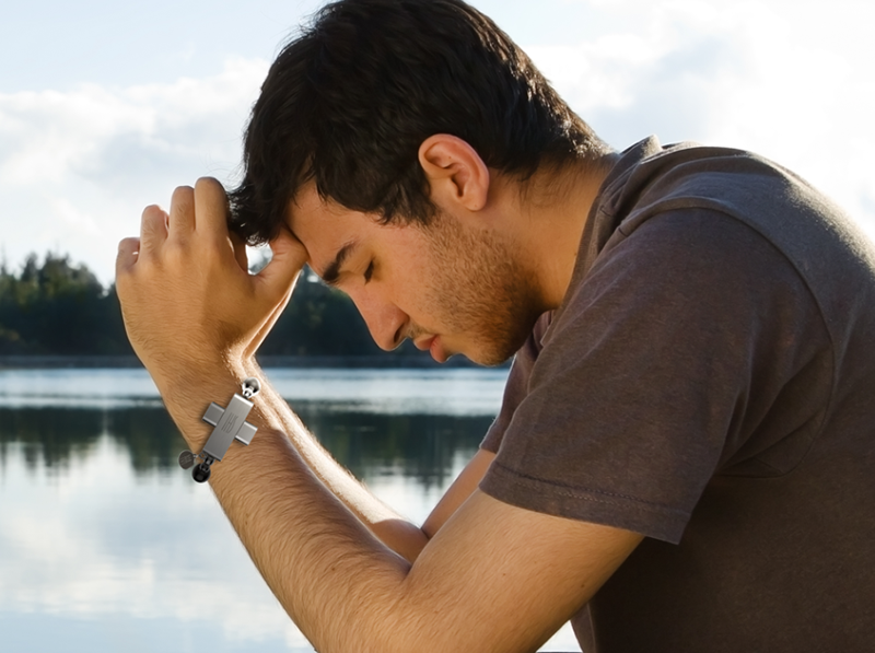 A man wearing rosary on his wrist