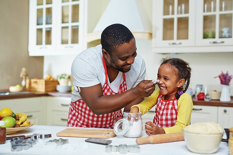 A man and a child cooking