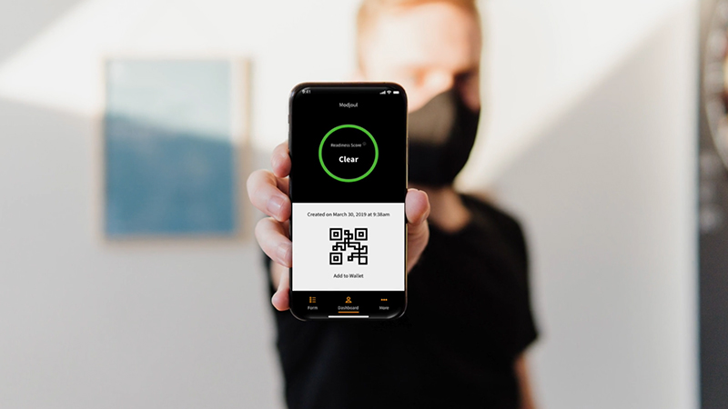 A person showing a mobile app
