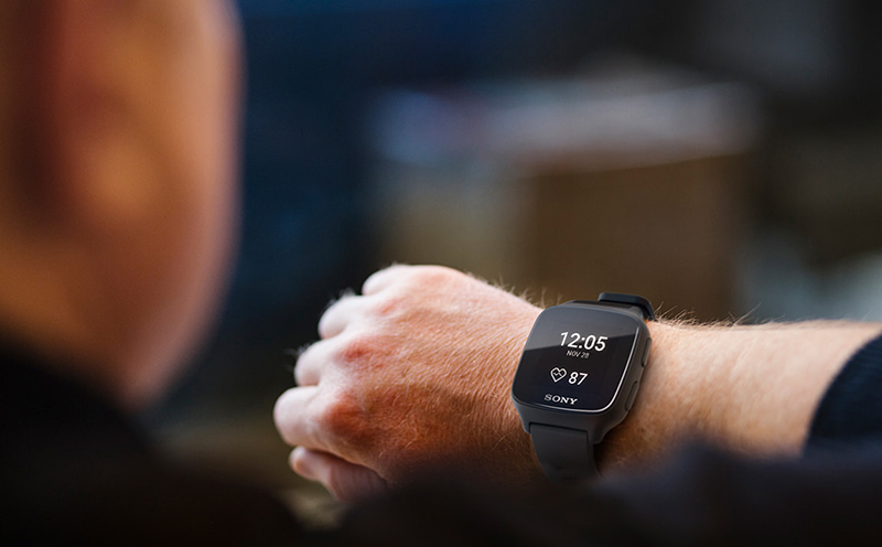 A person looking at a smartwatch
