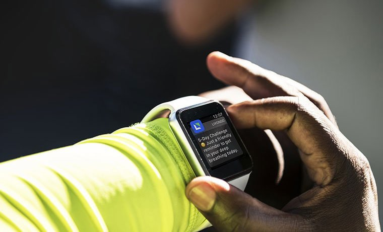 A person checking his smartwatch